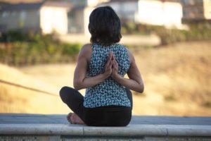 Yoga - Reverse Namaste with grounded Sits Bone